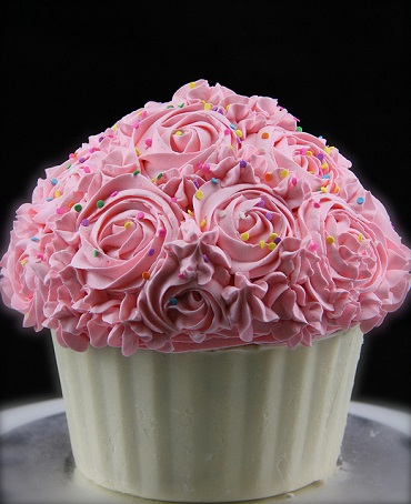 giant cupcake with buttercream and decorations